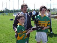 Conor Small & Ruairi McCann receiving their joint award from Leo Heatley