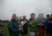 The experienced captain and man of the match accepts the trophy for the winning Creggan team.